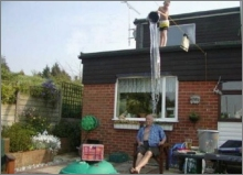 funny photo boy dump water roof